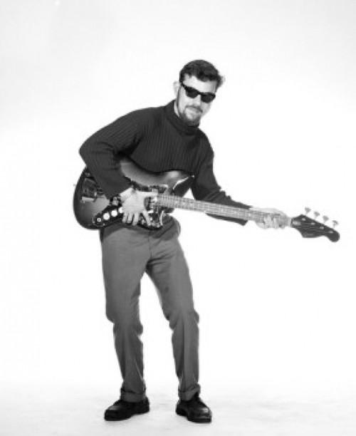 Portrait of young man playing base guitar Poster Print - Item # VARSAL255417684B