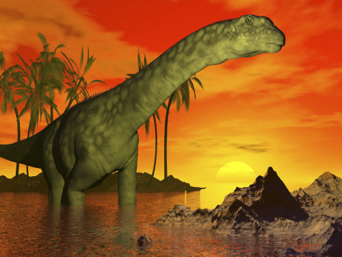 Large Argentinosaurus dinosaur standing in water next to palm trees backdropped by a beautiful sunset Poster Print - Item # VARPSTEDV600084P