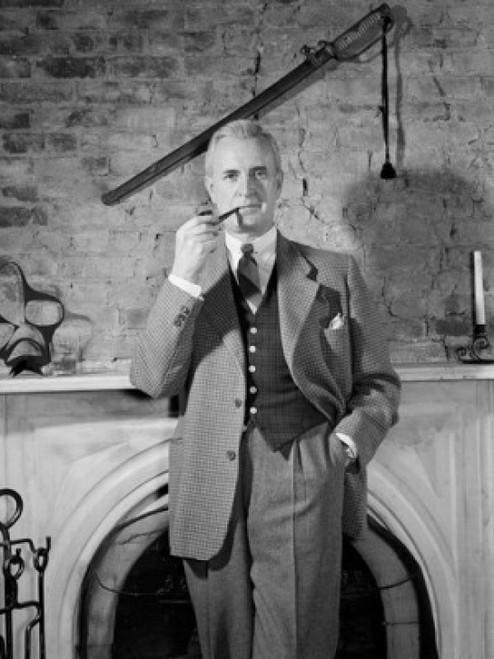 Elegant man standing by fireplace and smoking pipe Poster Print - Item # VARSAL2556663