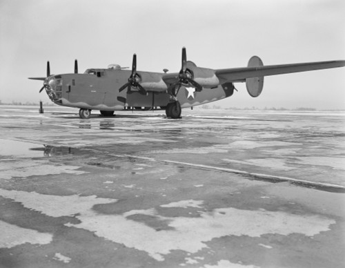 A B-24E Liberator bomber on the tarmac at Willow Run, Michigan. Poster Print by Stocktrek Images - Item # VARPSTSTK501056A