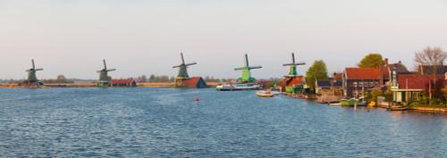 Windmills along the Zaan River at Zaanse Schans, Zaandam, North Holland, Netherlands Poster Print by Panoramic Images - Item # VARPPI158176