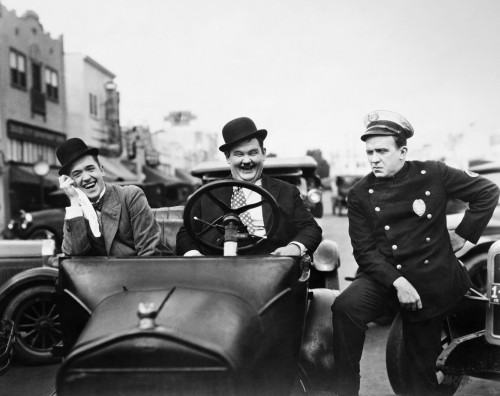 Laurel And Hardy, 1928. /Nstan Laurel, Left, And Oliver Hardy With A Police Officer In The Silent Film 'Leave Them Laughing,' 1928. Poster Print by Granger Collection - Item # VARGRC0122547