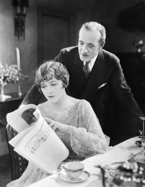 Silent Film Still: Reading./Nanna Q. Nilsson And Lewis Stone In 'The Talker,' 1925. Poster Print by Granger Collection - Item # VARGRC0073744