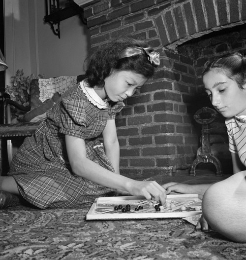 Chinese Checkers, 1942. /Na Chinese-American Girl Playing Chinese Checkers With Her Jewish Friend At Home In Flatbush, Brooklyn, New York. Photograph By Marjory Collins, 1942. Poster Print by Granger Collection - Item # VARGRC0323828