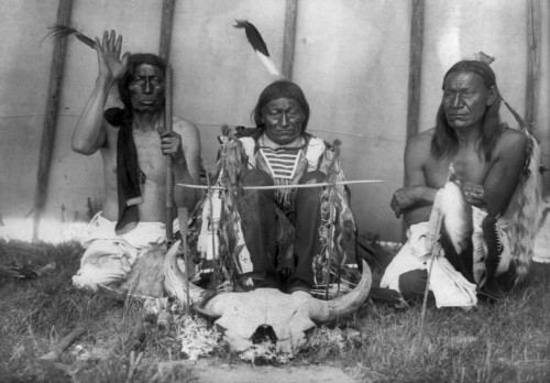 Teton Ritual, C1907. /Nthree Teton Native American, Slow Bull, Salive And Picket Pin, Kneeling With A Bison Skull Inside A Teepee. Photograph By Edward Curtis, C1907. Poster Print by Granger Collection - Item # VARGRC0170265