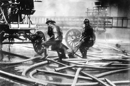 Triangle Factory Fire. /Nfirefighters Carrying The  Body Of A Victim Of The Triangle Shirtwaist Factory Fire. Photograph, 25 March 1911. Poster Print by Granger Collection - Item # VARGRC0395117