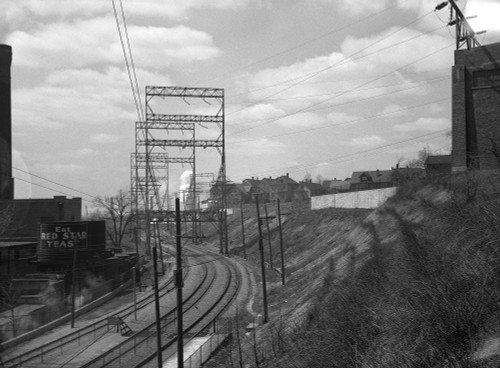 Electric Railroad, 1936. /Nhouses Alongside The Chicago And Milwaukee Railroad, Milwaukee, Wisconsin. Photograph By Carl Mydans, April 1936. Poster Print by Granger Collection - Item # VARGRC0121114