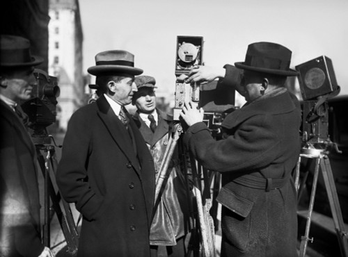 Photographers, 1922. /Namerican Politician And Lawyer Will Hays (Left) Watches A Photographer Load A Movie Camera, In Washington, D.C., 1922. Poster Print by Granger Collection - Item # VARGRC0126309