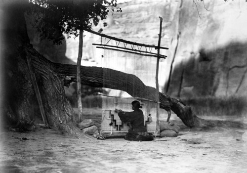 Navajo Weaver, C1905. /Na Navajo Woman Weaving A Blanket Under A Cottonwood Tree, With A Canyon Wall In The Background. Photograph By Edward Curtis, C1905. Poster Print by Granger Collection - Item # VARGRC0117220