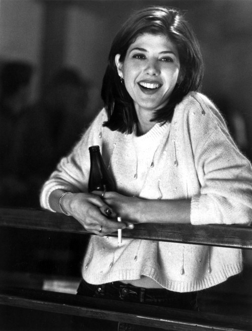 Marisa Tomei Leaning in White Sweater with Beer and Cigarette Photo Print - Item # VARCEL708918