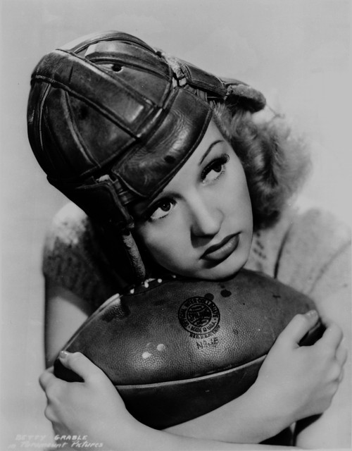 Betty Grable Posed with a Football Photo Print - Item # VARCEL695380