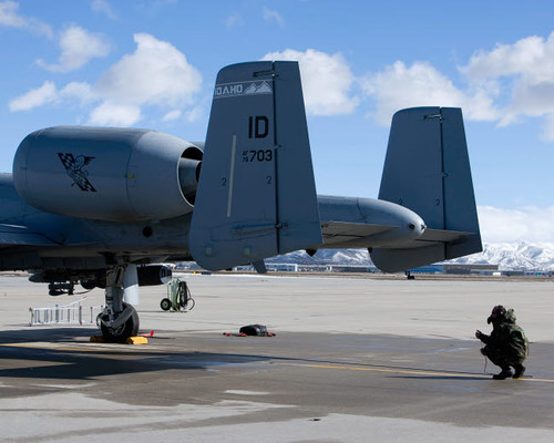 A crew chief performs preflight inspections on an A-10 Thunderbolt Poster Print by HIGH-G Productions/Stocktrek Images - Item # VARPSTHGP100372M