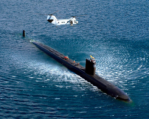 A CH-46 Sea Knight hovers above an attack submarine Poster Print by Stocktrek Images - Item # VARPSTSTK101365M