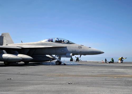 A shooter signals the launch of an F/A-18F Super Hornet Poster Print by Stocktrek Images - Item # VARPSTSTK105604M