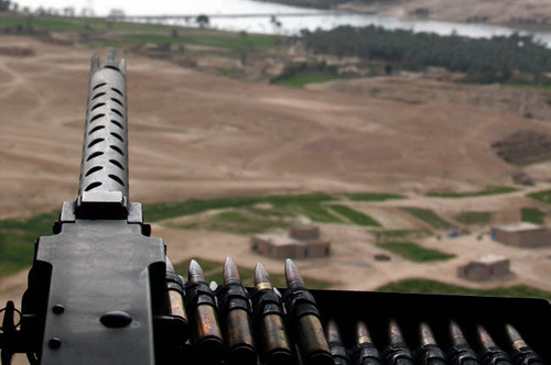 A 50-caliber machine gun mounted on a CH-46 Sea Knight Poster Print by Stocktrek Images - Item # VARPSTSTK102082M