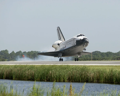 Space Shuttle Endeavour touches down on the runway at Kennedy Space Center Poster Print by Stocktrek Images - Item # VARPSTSTK202987S
