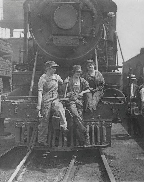 Women laborers seated on front of engine at Bush Terminal railroad yard, 1918 Poster Print by Stocktrek Images - Item # VARPSTSTK500107A