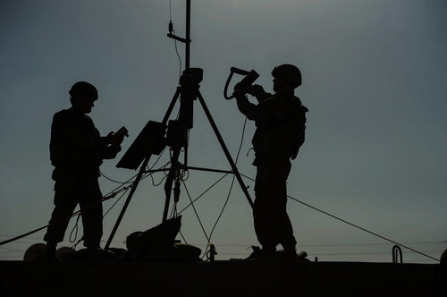 US Air Force members conduct an inspection of a weather sensor Poster Print by Stocktrek Images - Item # VARPSTSTK106633M