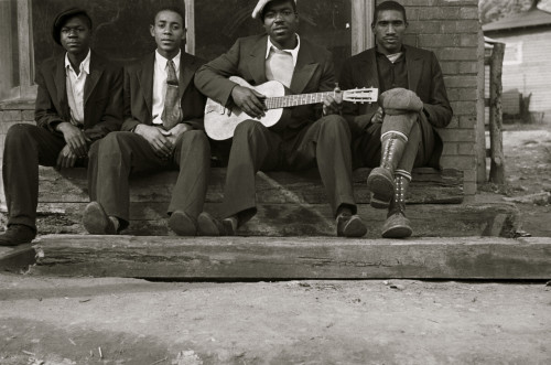 African American on bench while one plays the guitar Poster Print - Item # VARBLL058744882L