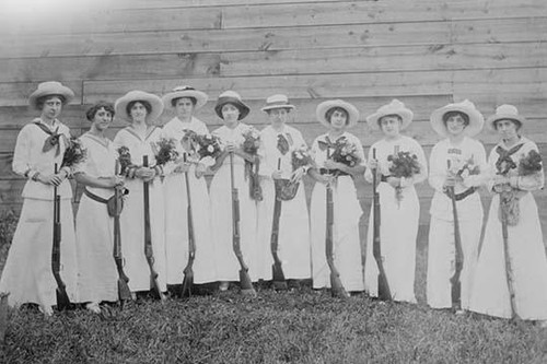 Nemours Women's Trap shooting Club in elegant dress hold both nosegays and rifles. Poster Print - Item # VARBLL058746062L