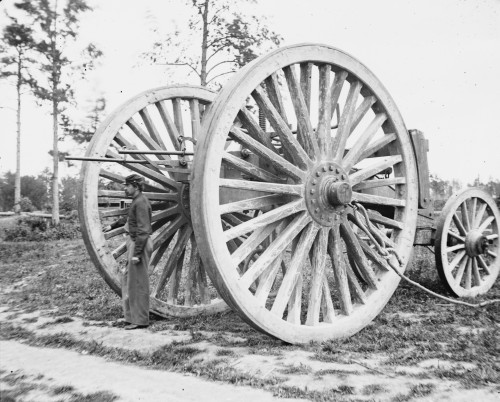 Soldier stands beside a Civil War Union Sling cart used in removing the captured artillery Poster Print - Item # VARBLL058746561L