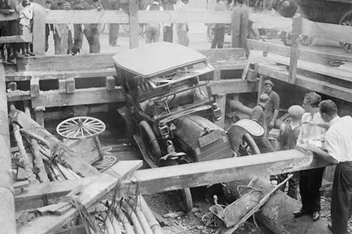 Taxicab Falls into New York's 7th Avenue Subway Excavation; the street's collapse engulfs a taxi as it comes to rest below street level on a large water pipe. Poster Print by unknown - Item # VARBLL058745929L