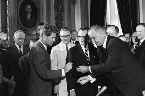 1965 Voting Rights Signing Ceremony. President Lyndon Johnson Handing A Signing Pen To Robert Kennedy As Others Look On. August 6 History - Item # VAREVCHISL033EC430