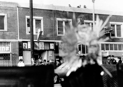 A Bullet Hole In A Storefront Window Was Made During Four Hours Exchange Of Gunfire Between Los Angeles Police And Black Panthers. Dec. 8 History - Item # VAREVCCSUA001CS380