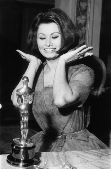 Sophia Loren As She Receives The Oscar Statuette From Producer Joseph Levine In Rome History - Item # VAREVCCSUB001CS597