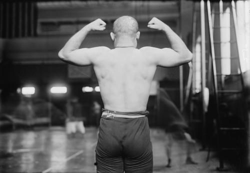 Strong Man Flexing Muscles History - Item # VAREVCHCDLCGCEC024