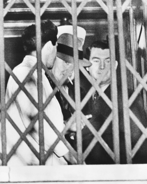 Tammany Boss Jimmy Hines Was Convicted Of Protecting The Dutch Schultz Mob. Hines Smoked A Cigarette Behind The Fence At The General Session Court After His Conviction History - Item # VAREVCCSUB002CS009