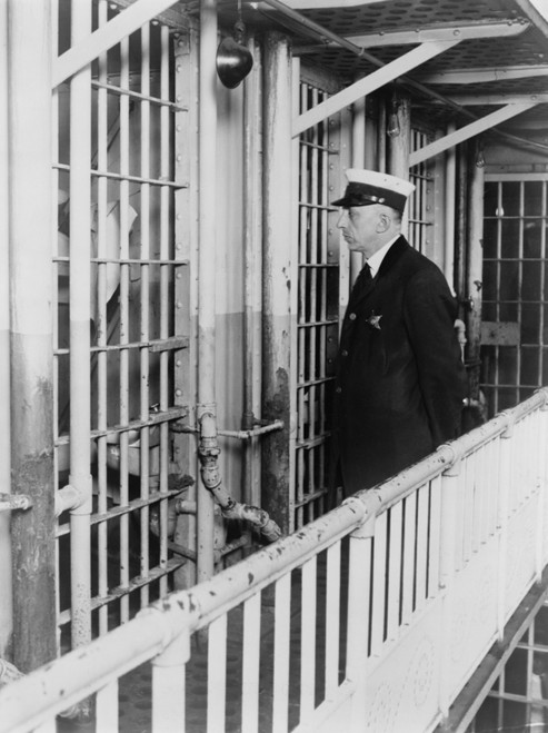 A Prison Guard At The Cook County Jail Standing Outside The Cell Of Confessed Thrill Murder Nathan Leopold History - Item # VAREVCHISL010EC261