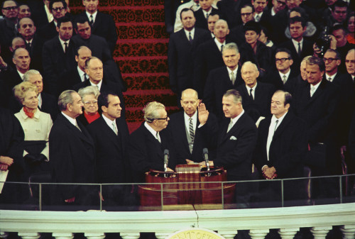 Vice-President Elect Spiro Agnew Takes The Oath Of Office From Senate Minority Leader Everett Dirkson. Also Pictured Are Lyndon Johnson Richard Nixon Hubert Humphrey Billy Graham. Jan. 20 1969. History - Item # VAREVCHISL032EC164
