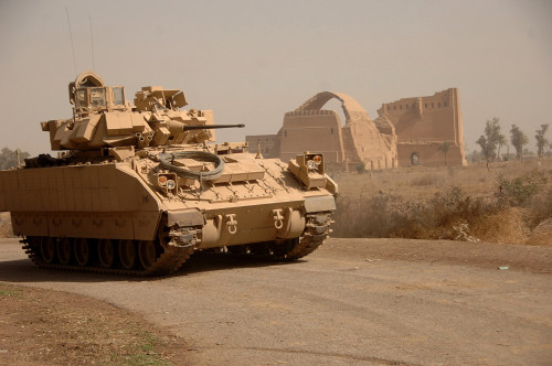 Us Bradley Fighting Vehicle Passes By The Ruins Of The Palace Of Historic Ctesiphon One Of The Great Cities Of Ancient Mesopotamia. Feb. 16 2008. History - Item # VAREVCHISL027EC157