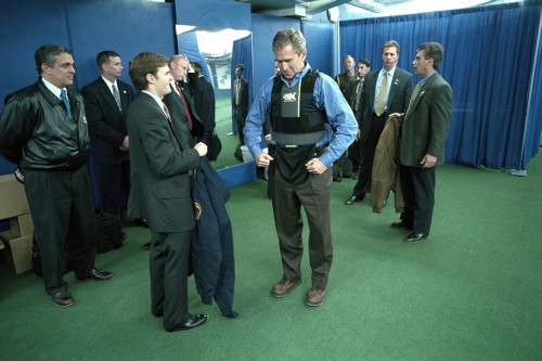 President George W. Bush Puts On A Vest Before The First Pitch In Game 3 Of The World Series. At Left Is Cia Director History - Item # VAREVCHISL039EC932