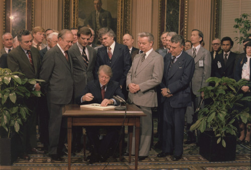 Jimmy Carter Signs A Social Security Act On December 20 1977. The Law Rewarded Workers Over The Age Of 65 Adjusted Ss Taxed In Favor Of Low And Middle Income Workers And Further Protected Spouse Benefits. History - Item # VAREVCHISL029EC078