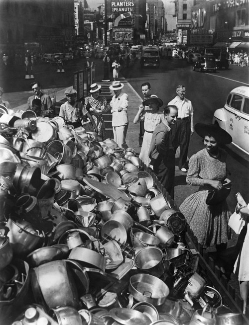 Collection Point In New York City For Aluminum During World War 2. Ca. 1942-45. African American And White Pedestrians Smile At The Pots Collected For The War Effort. History - Item # VAREVCHISL036EC869