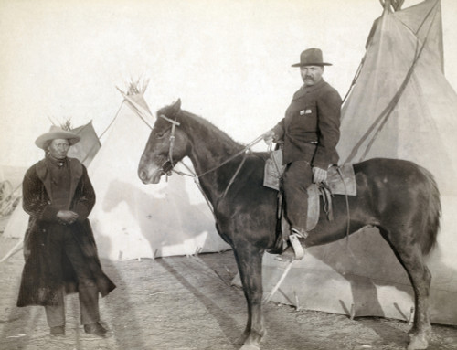 Sioux Chief, 1891. /Nthe Oglala Sioux Chief Rocky Bear Standing In Front Of Tipis Beside An Unidentified White American Man On Horseback. Photographed In 1891 By John C.H. Grabill, Probably On Or Near The Pine Ridge Reservation In South Dakota. Poste