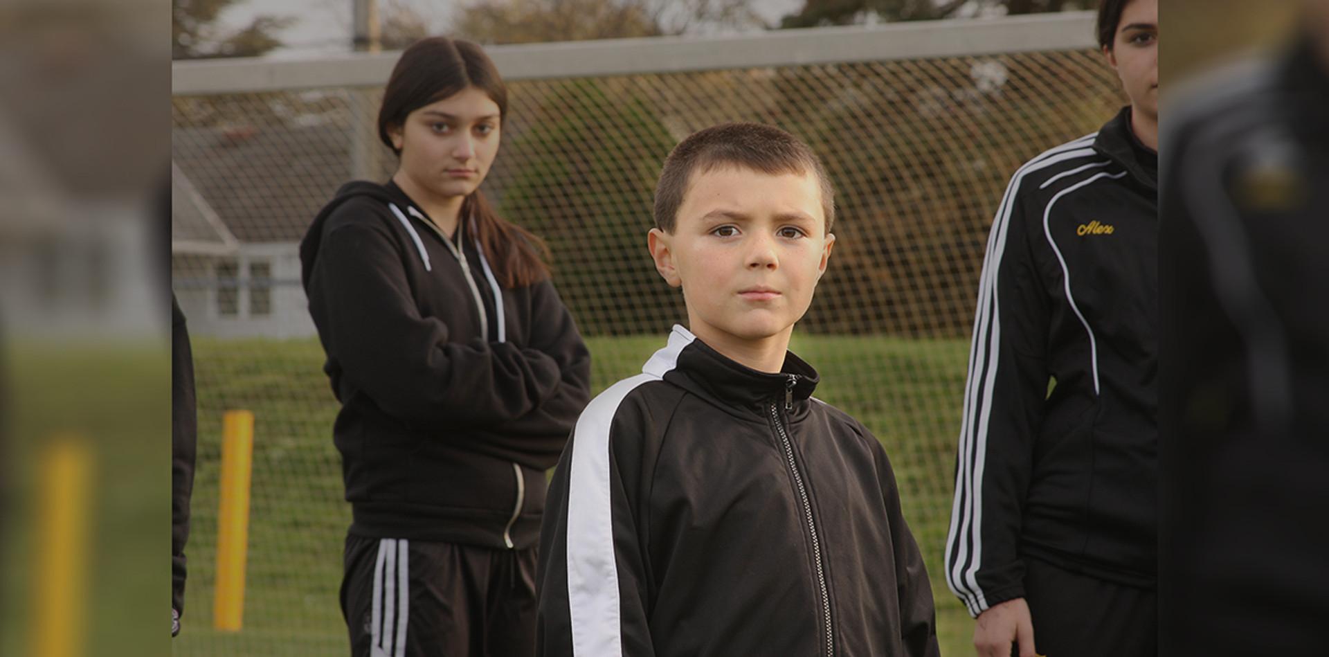 3 kids on field