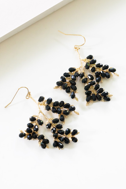 Gold cascading leaves with faceted black crystals