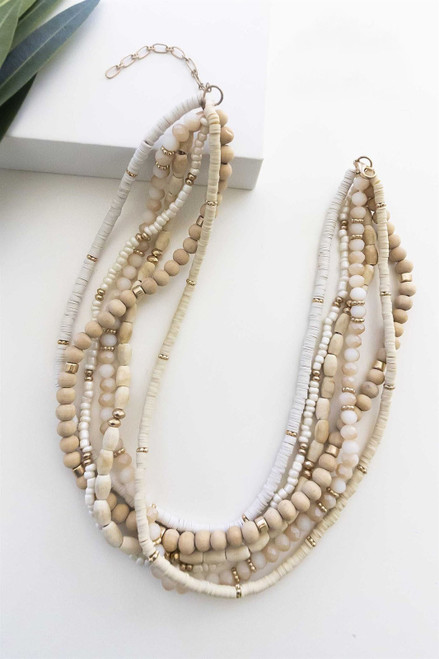 Thick layered cream and natural wood beaded necklace