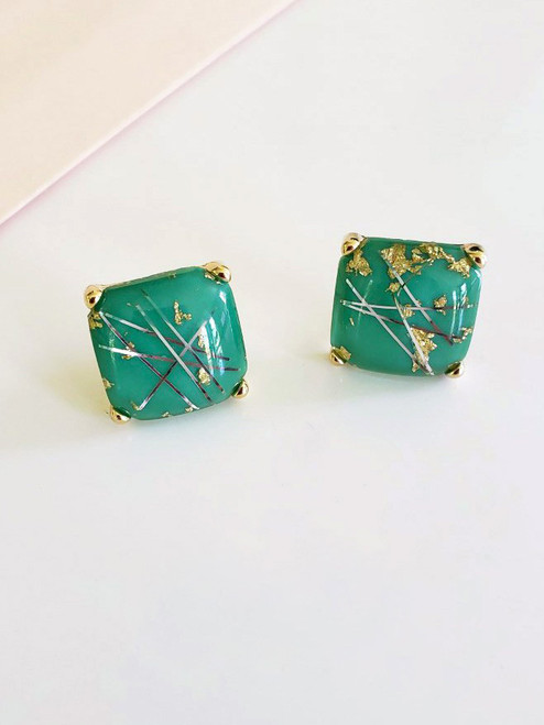 Half inch square emerald resin stud earrings embedded with silver and gold tinsel