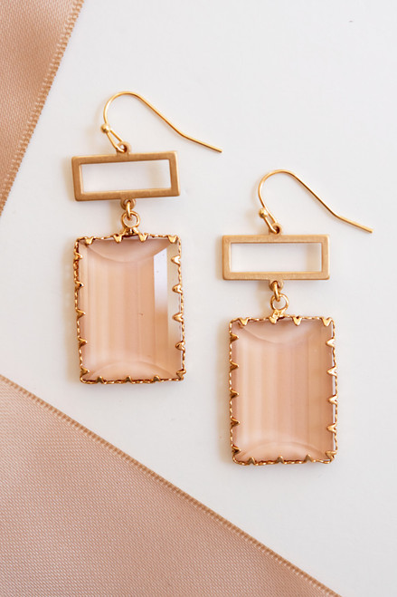 Gold rectangular drop earrings with blush crystal.