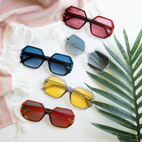 Geometric frame sunglasses in a variety of jewel tone colors
