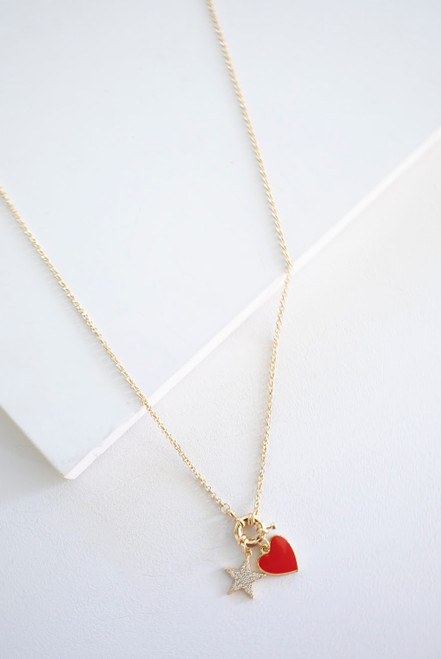A darling and delicate necklace with an enamel red heart pendant, accented with a gold star charm.