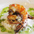 cooked tiger shrimp with ginger rice and herb oil
