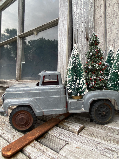 vintage toy truck with trees