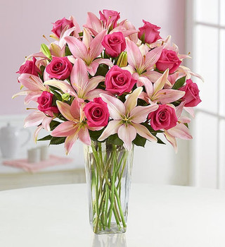 Magnificent is the only way to describe our boldly beautiful bouquet. We've gathered one dozen long-stem pink roses with six, multi-bloomed pink Asiatic lilies for a gift that's sure to make an impression.  12 long-stem pink roses paired with 6 pink Asiatic lilies, Shades of pink may vary
