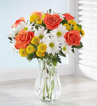 Gathering of white daisies, orange roses, and yellow button poms with greenery