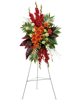 This radiant spray of red and orange flowers will be a lovely reminder.The stunning arrangement includes orange Asiatic lilies, red gladioli, green carnations, peach hypericum, emerald palm and red ti leaves, accented with assorted greenery.